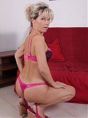 Mature pornstar Nela strips down and lures a younger guy into fucking her on webcam