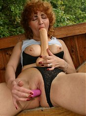 Busty redhead granny kneading her big breasts while cramming a huge dildo inside her poon live